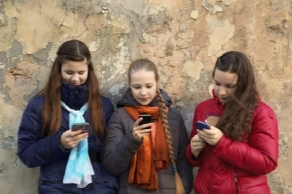Three girls on phones