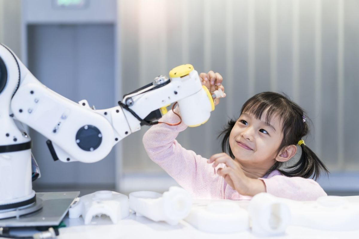 Little girl with robot arm smaller